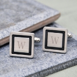 Give the gift of distinction with our Black Border Designer Cuff Links. Both masculine and stylish, these tuxedo treasures will give every man the perfect finishing touch. Everyone from groomsmen and guy friends to fathers and brothers will look dashing as they top off their suits with the sophistication these black trimmed links provide. And because each set is engraved with their initial, theyre guaranteed to be a wardrobe favorite!