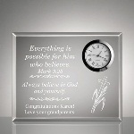"Choose a religious gift that genuinely offers inspiration with our clear acrylic desk clock. This unique design in desktop clocks offers encouragement and personal motivation. Authentic quart clock with roman numerals makes sophisticated spiritual gift. Measures 5"" x 4"" x 3/4"" for convenient display and features a symbolic cross and other decorative detailing. Your loving support will never be forgotten by your recipient and will last a lifetime."
