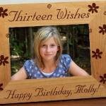 "Celebrate a 13th birthday with our personalized Thirteen Wishes Wooden Frame.  This Personalized Wooden Birthday Frame measures 8 3/4""x 6 3/4"" and holds a 3½""x5"" or 4""x6"" photo. Easel back allows for desk display."