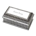 "She will love storing her beautiful trinkets and jewelry in this delightful silver jewelry box. 4.25"" x 3"" x 2"" , this exquisite box features an elegant floral pattern. The smooth silver face can be personalized with her name or initials. Standing upright on four petite legs, this charming little jewelry box is a keepsake that she will treasure."