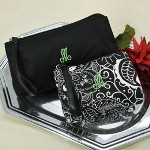 "Our set of Black Damask Wristlet Purses will make an ideal gift for all girls on the go! Whether youre heading to class, a night on the town or out to dinner with family and friends, these ultra trendy purse alternatives will be the perfect ""go-to"" accessory. Fashioned in sturdy canvas, each wristlet features a super stylish black and white damask print, free personalization and three interior compartments for easy organization. The smaller version, lined in black, will add pop to any ensemble; while the larger, all black version, lined in damask, will easily match any outfit for any occasion. Youll get the functionality of a wallet without the bulk of a purse!"