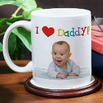 The birth of a child, the birthday of a loved one or a special event are all great times to remember with a Personalized Photo Coffee Mug. Mom, Dad, Grandma, Grandpa or favorite Aunt will love receiving this precious mug personalized with a favorite photo with a bright & cheerful caption from the kids. Our I Love Personalized Photo Coffee Mug is available on our Dishwasher safe Ceramic Coffee Mug and holds 11oz. Includes FREE Personalization! Upload your favorite digital photo below. Please dont send any photos in the mail, electronic photos only. Please enter description of photo. (ex. Lady kissing baby girl on cheek) Personalize your I Love Personalized Photo Coffee Mug with I or We. Recommended pixel resolution (dpi) is at least 500 x 500.