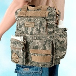 "This cotton/polyester diaper bag is covered in modern camouflage. Zippers are used to close the pockets of this bag, which is designed to be carried over the shoulder. One side pocket is designed for a baby bottle (bottle not included). The bag measures 12.5"" x 16"". One lower pocket is accented with a round logo that reads ""DADDY, Always Ready, Always There."" A rectangular logo near the top of the bag reads ""FATHERS CREED: I am a father. I have answered my childs call. I will not quit. I will not fail."""