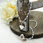 Our Personalized Pearl Bracelet with Locket Charm is a great gift for all the girls on your list! This attractive sterling silver-plated bracelet features white glass pearls and a heart charm pendent that may be engraved for added value. A true find! Includes a free organza gift pouch. The Personalized Pearl Bracelet with Locket Charm may be engraved with a single, uppercase script initial at No Additional Cost.