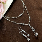 Gracefully designed with freshwater pearls and Swarovski crystals, our Freshwater Pearl Double Drop Jewelry Set will add an elegant touch to your special day. Constructed with a sterling silver-plated setting, this earrings and necklace duo will sparkle for you. So, wear it to everything from your wedding day to a night out on the town. Were sure you wont be disappointed! Set includes pierced earrings and adjustable necklace. Available in white and ivory. (Shown in white)