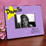 "Celebrate this splendid occasion with a Personalized Graduation Picture Frame holding your favorite Graduation Picture. Our Be a Star Graduation Picture Frame reminds any graduate of years of hard work and commitment and becomes a unique keepsake they'll enjoy year after year. Our Personalized Graduation Frame measures 8"" x 10"" and holds a 3.5"" x 5"" or 4"" x 6"" photo. Easel back allows for desk display or ready for wall mount. Includes FREE Personalization! Personalize your Graduation Picture Frame with any name."