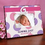 Celebrate the arrival of your new baby girl with this adorable Personalized New Baby Girl Polka Dotted Picture Frame. Her picture is sure to look beautiful when displayed in this lovely New Baby Announcement Photo Frame and makes a wonderful gift idea for any new parent in your life.