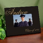 "This handsome and sophisticated Personalized Class of Graduation Photo Frame will look even better holding a photo of your new grad. Celebrate this glorious occasion by presenting any new graduate with our Personalized Graduation Frame that reminds them of the hard work and dedication it took them to be where they are today. Our Personalized Graduation Frame measures 8"" x 10"" and holds a 3.5"" x 5"" or 4"" x 6"" photo. Easel back allows for desk display or ready for wall mount. Includes FREE Personalization! Personalize your Graduation Picture Frame with any name and year."