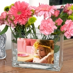 This rectangular vase is constructed of thick clear glass with an inset base. On the broad front of the glass vase is a protective insert for a special photo. Above the photo, you can choose a custom engraved line in a sophisticated block print. Our Glass Photo Vase makes an ideal gift for both men and women. Create a one-of-a-kind gift by inserting a favorite photo and having a special sentiment engraved at the top of the vase. The vase can hold either real or dried flowers, making it a great gift for birthdays, special occasions, holidays, or even just to say thank you!