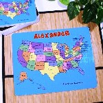 "Teach your child the 50 states and their Capitals all while creating a fun way to learn. This delightful map of the United States presents all 50 states in colorfully illustrated puzzle pieces that truly make it memorable. Perfect for your child's Birthday, Christmas or a unique Back to School Gift idea. Your Personalized USA Puzzle is a one of a kind keepsake for holidays or special occasions. Our high quality, high gloss jigsaw puzzle is a sturdy jigsaw puzzle and measures 10.5"" x 13.5"" x 130pc. Each Personalized Jigsaw Puzzle includes FREE Personalization! We will Personalize your USA Jigsaw Puzzle with any name. (ie. Alexander)"