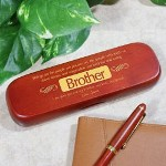 "Having a brother is a blessing. He is there with support, love and a big hug when you need it. Honor your big or little brother with a Personalized Brother Pen Set. A handsome, personalized gift made especially for him by you. Engraved Pen Set for your Brother is presented with a matching rosewood case for convenient storage and makes a handsome gift presentation. Pen measures 6"" in length, black ink and features twist action ballpoint operation. The pen can be refilled with a standard Parker refill. The Engraved Brother Pen Case is personalized with any two line custom message. (i.e. I am glad your are my brother, my hero, my friend. / Love, Jamie )"