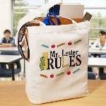 "This sturdy and personalized canvas tote bag is a wonderful gift for your favorite teacher. Whether carrying papers to grade or books to read; this Personalized Teacher Tote Bag will be used on a daily basis. Each Personalized Tote Bag is available on our premium 100% cotton canvas, machine washable Tote Bag measuring 16""h x 14""w. Includes FREE Personalization! Personalize your Teacher Tote Bag with any name."