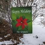 "Our Poinsettia Garden Flag is a great accent to any yard or garden, our personalized garden flags are a unique way to greet any guests arriving at your home. Flag measures 11.25""x 14.75"". Personalize with any last name. Wrought Iron Flag Pole measures 39.25"" Tall and is sold separately."
