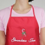 This lovely Personalized Christmas Candy Cane Apron makes a great Christmas gift. Outfit Mom, Grandma, Aunt or favorite cook with this attractive embroidered Christmas apron.