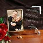 "Celebrate the love you have for each other by giving our Personalized Anniversary Picture Frame featuring a lovely engraved poem along with your loving sentiments. Our Personalized Anniversary Beveled Glass is a heavy-weight glass with beveled edges on all sides, accented with golden brass frame trim. Frame measures 8"" x 11"" and holds your 4"" x 6"" photo; includes clear easel legs for top display. Includes FREE Personalization! Personalize your Anniversary Beveled Glass Picture Frame with any one line message (ie: Happy Anniversary), the couples names and date."
