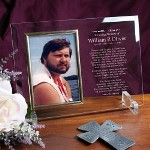 "The loss of a close family member or friend is difficult. This beautifully engraved memorial picture frame is sure to sooth the heart during this time of mourning. A Personalized Sympathy Picture Frame makes a thoughtful personalized sympathy gift that will be treasured for years to come. Our Personalized Memorial Beveled Glass Picture Frame is a heavy-weight glass with beveled edges on all sides; accented with golden brass frame trim. This Engraved Picture Frame measures 8"" x 11"" and holds your 4"" x 6"" photo. Each Personalized Glass Picture Frame includes clear easel legs for tabletop display. Includes FREE Personalization! Personalize your Sympathy Beveled Glass Picture Frame with any name and dates. Please specify he or she for the poem or Create Your own Poem with up to 20 lines."