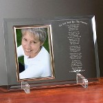 "Christmas is a beautiful time of the year to remember a loved one who has passed. Your Personalized Christmas Bereavement Frame displays your loving keepsake photo along side a thoughtful poem honoring your precious loved one. Our Personalized Christmas Bereavement Beveled Glass Picture Frame is a heavy-weight glass with beveled edges on all sides, accented with golden brass frame trim. Personalized Picture Frame measures 8"" x 11"" and holds your 4"" x 6"" photo; includes clear easel legs for top display. Includes FREE Personalization! Personalize your Engraved Christmas Memorial Picture Frame with any name and year."