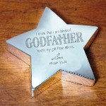 "Choosing a Godfather is an important part of a baptism or christening and when you have him chosen, you know he'll be the best for your child. Thank him for accepting this special offer with our Engraved Godfather Silver Star Keepsake that show's you are blessed to have him at your side at all times. Our handsome Silver Engraved Godfather Star Keepsake measures 4.25"" x 4.25"" and is 1"" in height. Each Engraved Godparent Star Keepsake includes FREE personalization! Personalize your Silver Star Keepsake with any name. (ie. Nicole Marie) Godfather Keepsake reads: I know that I am blessed, Godfather, Youre a gift from above."