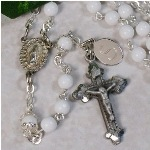 Personalized First Rosary - Perfect Engraved Rosary for Any Occasion Whether its a Christening, First Holy Communion, or for your Wedding day, our charming religious First Rosary will bring remembrances of that special day. Each Personalized Rosary is beautifully engraved creating a most memorable keepsake to pass on from generation to generation. Our lovely White Pearl First Rosary is rhodium-plated. Includes FREE Personalization. Engrave your First Rosary with any single initial.
