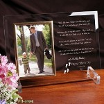 "Create a great Fathers Day gift by personalizing this handsomely Engraved Glass Picture Frame with your personal sentiment and our Follow In Your Footsteps, Fathers Day Poem. He will enjoy every word and your favorite picture. Our Engraved Fathers Day Glass Picture Frame is a heavy-weight glass with beveled edges on all sides, accented with golden brass frame trim. Frame measures 8"" x 11"" and holds your 4"" x 6"" photo; includes clear easel legs for top display. Includes FREE Personalization! Personalize with any closing sentiment message, up to three lines (30 characters per line) after the Dad poem. (i.e. Happy Fathers Day\I love you,\Bryce)"