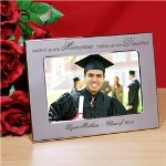 Display your favorite memories from graduation with our Personalized Memories and Dreams Graduation Silver Picture Frame. A great gift to show someone how proud you are for their achievements. This attractive Graduation Keepsake is sure to bring fond memories of days long past. Behind us are Memories...before us are Dreams...
