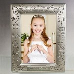 Your child is sure to look great when their first communion photo is displayed inside this Engraved My First Communion Picture Frame. This Engraved First Communion Frame is a wonderful keepsake to remember their special day and is a constant reminder of the importance of their Catholic faith.