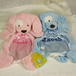"This adorable, lovable, cuddly, doggy Personalized Baby Blanket is soft plush on the outside and smooth satin on the inside. Nap time is sure to be welcomed by your little one with this warm & comfortable Personalized Baby Blanket. Our Baby Personalized Baby Blanket is a 20"" Gund Spunky™ Huggybuddy™. Machine washable. Includes FREE Personalization! Personalize your Personalized Baby Blanket with any name. Makes a great Baby Shower Gift. Please choose color. Makes a Great Personalized New Baby Gift!"