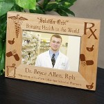 "A Personalized Pharmacist Picture Frame proudly displays the photograph of your family pharmacist. A great Pharmacist Graduation Gift for the family to enjoy every day. Our Pharmacist Medical Professional Frame measures 8 3/4""x 6 3/4"" and holds a 3½"" x 5"" or 4"" x 6"" photo. The Pharmacist picture frames include an easel back that allows for desk display or can be hung on the wall. Includes FREE personalization! Personalize your Pharmacist Picture Frame with any two lines of custom personalization. (i.e. Dr. Bryce Allen, RPH / University of Southern California School of Pharmacy)"