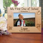 "Our personalized First Day of School Picture Frame makes a keepsake gift idea for any new student. Personalized with any school year, name and date. This Personalized First Day of School Picture Frame measures 8 3/4""x 6 3/4"" and holds a 3½""x5"" or 4""x6"" photo. Easel back allows for desk display."