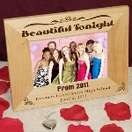 "There is no better way to capture a monumental occasion than a charmingly framed photograph! Document this occision with a finely crafted, personalized frame. Have the school name, the year, and the date engraved, as well as a choice phrase atop the frame! Engraved Prom Night Wooden Picture Frame measures 8 ¾"" x 6 ¾"" and holds a 3 ½"" x 5"" or 4"" x 6"" photo. Each Personalized Prom Frame includes an easel back that allows for desk display. Engraved Prom Frames include FREE Personalization! Personalize your Prom Picture Frame with any Top Caption, Bottom Caption, School Name and Prom Date. (ie. Beautiful Tonight / Prom 2011 / Downers Grove South High School / June 2, 2011)"