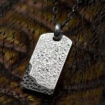 Create something special by engraving the back of this shiny stainless pendant with a specail message in traditional or black laser. The words Believe and Trust are etched randomly across the front. The shiny black enamel area at the bottom of the pendant creates an elegant look. Chain: 20 in. silver ball chain