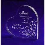 "Finding the right Mother's Day gifts means taking time to find something that is unique and special for the mother who means so much to you. An appealing acrylic heart resting on its side offers the opportunity for a special message from you. Engraved on this stylish 4-3/4"" x 4-3/4"" heart with its beautiful floral design this will be a keepsake that any mother will adore and treasure forever."