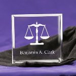 "A wonderful little gift for a lawyer, or lawyer to be. This Tiny Treasure is engraved with legal scales and the recipients name. These adorable keepsake blocks come with a velvet pouch to keep them dust free. Blocks measure 2 1/2"" x 2 1/2"" and are 1"" thick, so they can stand on their own."
