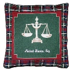"Recognize your hard-working attorney, professor or friend with this outstanding lawyer tapestry pillow. These 16"" by 16"" pillows have a plaid cotton background, while featuring the traditional lawyerly image of the scales on the red and green foreground, and are fitting gifts for lawyers. Each cotton throw pillow can be custom-embroidered with the attorneys professional name, for a handsome and winning present. These legal gifts will be warmly welcomed into any lawyers home, and are great idea for any legal gifts on your giving list."