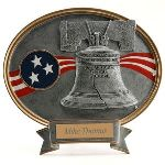 A traditional expression of true patriotism, this Liberty Bell Resin Oval Plaque is the best depiction. This 8 ½'' x 8'' plaque features a resin embossed image of the Liberty Bell along with the colors of the flag in the background. This Oval Plaque can be personalized with 2 lines on a plate which will be placed on the bottom of the plaque right on the ribbon. This plaque is the perfect way to remember someone's dedication and hard work.