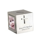 "A Trio of 2"" x 2"" photo frames are featured on three sides of this silver plated coin bank. This religious gift is ideal as a baptism, christening or First Communion gift. With a silver cross on the fourth side of the 2-3/4"" x 2-3/4"" x 2-3/4"" cube, you can add your personal message to this gift that will be loved by all."