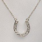 Our Tiffany style horse shoe necklace in sterling silver offers love and wishes of luck to a family member or friend. Great for graduation gifts, retirement gifts, or birthday gifts. Sterling - neck chain length is 16 inches.