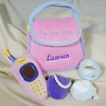 "Embroidered My First Purse - Personalized My First Baby Purse Your adorable little angel is going to love taking her very own Embroidered My First Purse every where she goes. This soft baby purse is perfect to tote to Grandmas or off to the mall with Mom. Your Personalized First Baby Purse measures 5"" x 5"". This four piece playset including a musical cellphone, soft & squeaky compact mirror and little change purse all perfect additions to this beautifully embroidered My First Purse. Includes FREE Embroidery. Personalize your My First Purse with any name ( ie. Lauren )"