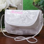 "Your Embroidered Flower Girl Purse includes an ornate satin purse embroidered with your daughters name in a soft pink thread.The embroidered purse measures 5 1/4"" x 7"", features a satin bow and is light weight, perfect for your daughters first trip down the aisle. Includes FREE Embroidery. Personalized your Flower Girl Purse with any name ( ie. Maria )"