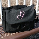 "Travel with ease and confidence knowing all of your necessary items are with you when you head out with your beautiful baby. Whether it is a trip to mall or going to Grandmas house all of your necessary diapers, bottles, wipes and additional baby apparel will travel in style with your embroidered diaper bag. This Personalized Diaper Bag also includes a folding changing pad and handy pocket for storage. Each embroidered bag is made of 600 denier polyester with zippered top compartment. Detachable nylon shoulder strap and can easily hang from any stroller. Diaper bag dimensions are 11 1/2"" h x 12 3/4"" w x 4 3/8"" d. Includes FREE Embroidery. Embroider you Baby Diaper Bag with any name or single initial in a block or script lettering. Choose between pink, blue or khaki thread colors."
