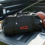 "Travel to your favorite cabin, beach resort or weekend getaway with this strong and robust Embroidered Travel Duffel Bag. This rugged bag is perfect for tossing in the back of the truck and heading out for a grand adventure. This embroidered bag is made for travel. Your Personalized Duffel Bag is 24 1/4"" x 12 1/4"" x 10 3/4"" in a bold black polyester material. Each Embroidered Duffel Bag is water-resistant with black web handles, detachable shoulder strap and zippered pockets. Includes FREE Embroidery in a choice of 12 thread colors. Personalize your Travel Duffel Bag with any name or three initials and thread color (ie. AGZ / Red)"