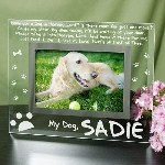 "Honor your lovable four legged friend by keeping a favorite photo of your dog in this beautifully Engraved Pet Memorial Frame. Each time you see your family's best companion in this attractive Memorial Frame, you will remember the joy & happiness that your family dog brought to your loving home. Your Engraved Glass Picture Frame measures 9"" x 7"" and holds a 3.5"" x 5"" or 4"" x 6"" photo. Easel back allows for desk display. Includes FREE Personalization! Your Personalized Pet Memorial Glass Picture Frame can be personalized with any name. (ie. Sadie)"