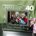 "Birthday celebrations are full of excitement, happiness and joy. Create a memorable gift shared with near and dear ones and add it to this beautifully Engraved Birthday Frame. This 40th Birthday Photo Frame is the most thoughtful birthday gift idea that is sure to make any birthday special. Our Personalized Birthday Frame measures 9""x 7"" and holds a 3½"" x 5"" or 4"" x 6"" photo. Easel back allows for desk display. Includes FREE Personalization! Personalize your Happy Birthday Picture Frame with any age, birth year, milestone year, and any one line custom message. (i.e. Happy Birthday, Sarah!)"
