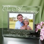 "Your anniversary is a special day the two of you share and enjoy together. Remember this precious time together with a Personalized Anniversary Picture Frame to showcase a favorite photograph. All of your family and friends will love your beautifully Engraved Picture Frame. A truly unique gift the two of you can enjoy forever.  Your Personalized Anniversary Glass Picture Frame measures 9"" x 7"" and holds a 3½"" x 5"" or 4"" x 6"" photo. Easel back allows for desk display. Wedding frame includes FREE Personalization! Personalized Anniversary Picture Frame includes anniversary couples names and anniversary date. Engraved Anniversary Frame reads: May every memory that you share of dreams youve seen come true, Help make this special day, A Happy one for you."
