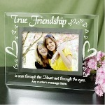 "Friendship is something that can not be broken by time or distance. True Friends are always together where ever they are. Display your favorite photograph of your friend in this unique friend gift or give your Best Friend a lovely Personalized Friend Picture Frame Keepsake as a special way of saying I was thinking about you today. Your Personalized Friendship Glass Picture Frame measures 9"" x 7"" and holds a 3½"" x 5"" or 4"" x 6"" photo. Easel back allows for desk display. Includes FREE Personalization. Personalize your True Friends Picture Frame with any one line custom message."