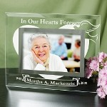 "Engraved Memorial Glass Picture Frame - Personalized Sympathy Gift A Personalized Memorial Picture Frame is a personalized sympathy gift that says everything you feel in your heart when the words are difficult to say. Give this Engraved Memorial Picture Frame to a close family member or friend to help them through the challenges of life. Your Personalized Sympathy Glass Picture Frame measures 9"" x 7"" and holds a 3½"" x 5"" or 4"" x 6"" photo. Easel back allows for desk display. Includes FREE Personalization. Personalize your Memorial Picture Frame with any name, birth year and death year."