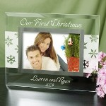 The trees will be glistening in white snow and the two of you will be looking your very best this Christmas when you give a Personalized Our First Christmas Glass Picture Frame to your Mom & Dad, Grandma & Grandpa or Aunt & Uncle. A splendid glass frame sure to look absolutely adorable in any home.