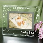 "This beautiful Engraved Baby Picture Frame features your Baby's Name and special date professionally Engraved for optimal presentation in your home or office. This unique Glass Baby Frame makes a lovely gift idea for any newborn baby or for a Christening or Baptism. Our Personalized Baby Photo Frame measures 9"" x 7"" and holds a 3½"" x 5"" or 4"" x 6"" photo. Easel back allows for desk display. Includes FREE Personalization! Personalize your Baby Rattle Baby Photo Frame with any name, date and choose Born, Christened or Baptised."