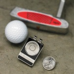"No more digging in your pockets for your ball marker. Our personalized, State Quarter ball marker/belt clip is a unique golf gift with style and personality. Constructed of sturdy stainless steel, the state quarter of your choice is permanently attached to a magnetic back that easily slips off the holder for easy marking with style. Perfect for a day on the links! Measures 1 ¾"" x 1 1/8"" x ½""."