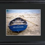 "This peaceful image of a trusty old rowboat on a quiet shore makes the perfect gift for life's special moments. Our framed and matted rowboat image is ideal as a retirement gift, is a great way to mark a memorable vacation or honeymoon, and makes a fun housewarming present for a new couple or homeowner. Also suitable as a corporate gift, this image features include a name on the back of the boat and two additional lines of up to 20 characters in the right-hand corner. Includes a custom black, beveled 23"" x 19"" wood frame with 3"" mat and glass front. Matted image measures 13 3/4"" x 11 3/4""."